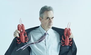 Jordan Peterson holding lobsters